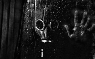 Обои человек, противогаз, рука, стекло, потеки, дождь, разное