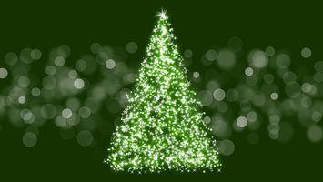 Фото бесплатно новогодняя елка, блики, блеск, зеленая елка, искры, вектор, новый год