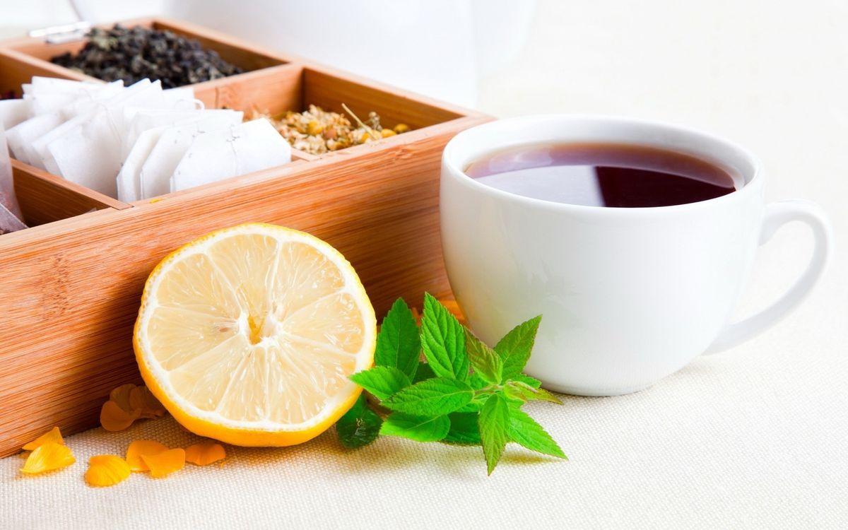 Фото бесплатно чашка, чай, лимон, мята, коробка, заварка, напитки