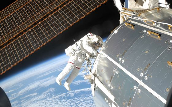 Photo free space station, astronaut, space suit
