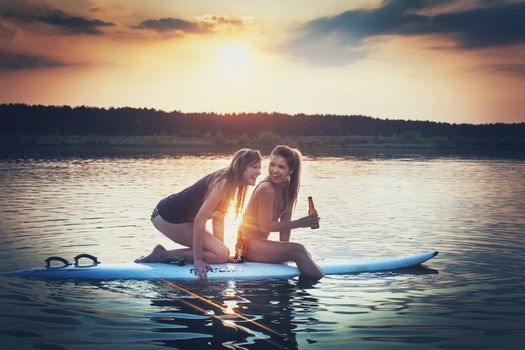 Photo free girls and surfing, board, sunset