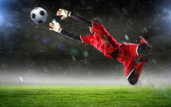 Бесплатные фото футбол,поле,вратарь,прыжок,полет,мяч