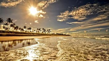 Бесплатные фото остров и пальмы,солнце,вечер,волны,океан
