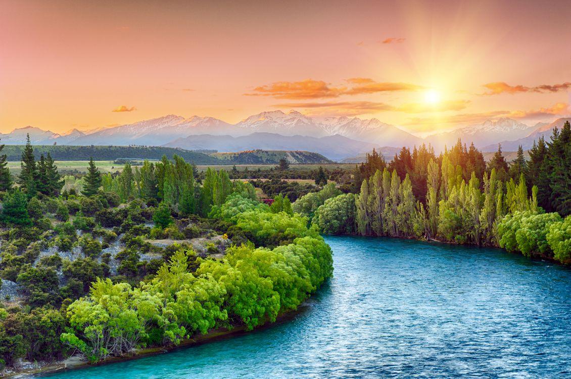 Фото бесплатно Clutha river, South Island, New Zealand, река, горы, деревья, закат, пейзаж, пейзажи