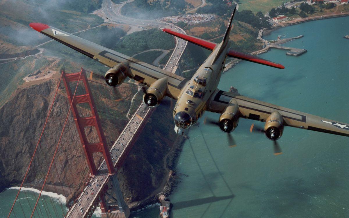 Фото бесплатно самолет, военный, крылья, винты, полет, земля, побережье, мост, авиация