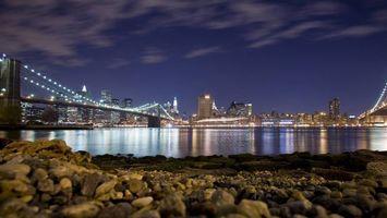 Бесплатные фото ночь,берег,камни,море,мост,подсветка,дома