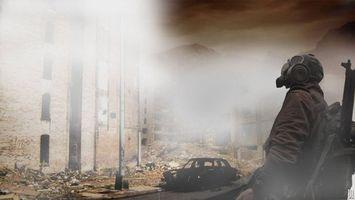 Фото бесплатно человек, противогаз, разрушенный город
