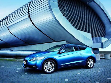 Бесплатные фото хонда,синяя,фары,диски,брусчатка,строение