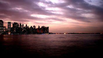 Заставки вечер, море, побережье, дома, небоскребы, огни