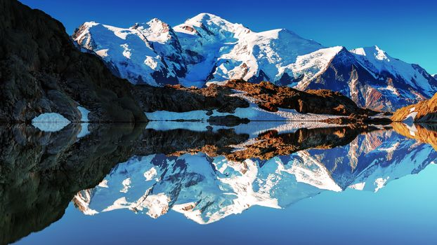 Photo free lake in the mountains, reflection of the mountains, sky
