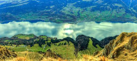 Бесплатные фото Швейцария,панорама,река,поля,горы,холмы,дома