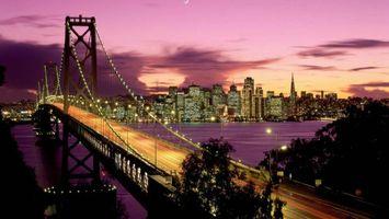 Бесплатные фото вечер,мост,конструкция,подсветка,деревья,река,дома