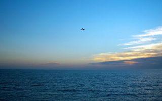 Бесплатные фото море,горизонт,небо,облака,самолет,полет