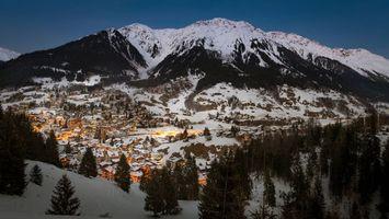 Бесплатные фото швейцария,Клостерс,горы,зима,дома,деревья,закат