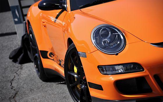 Фото бесплатно порше, оранжевый, фара
