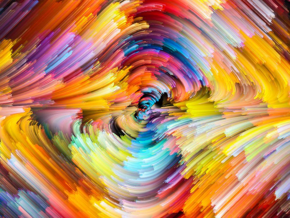 Разноцветный водоворот красками · бесплатное фото