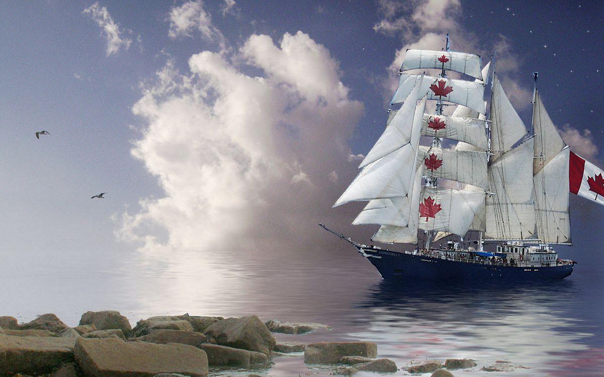Фото бесплатно берег, камни, море, корабль, мачты, паруса, флаг Канады, птицы, облака, корабли