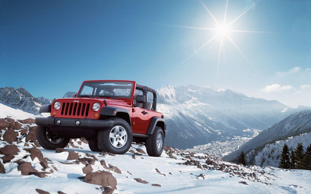 Фото бесплатно джип, красный, горы, камни, снег, небо, солнце, машины