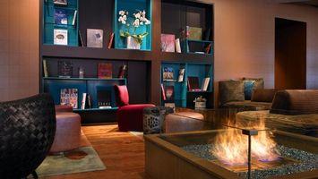 Бесплатные фото комната,шкаф,полки,пуфики,очаг,стекло,пламя