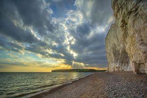 Фото бесплатно закат, море, берег, скалы, пейзаж