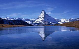Бесплатные фото озеро,отражение,горы,скалы,снег,небо