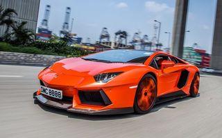 Фото бесплатно ламборджини, спорткар, оранжевый, фары, воздухозаборники, дорога, скорость