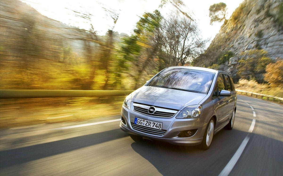 Фото бесплатно опель, горы, скалы, дорога, скорость, растительность, машины