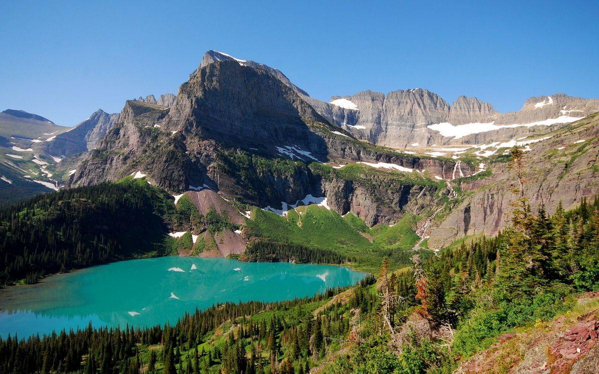 Фото бесплатно озеро, горы, скалы, деревья, трава, снег, небо, природа
